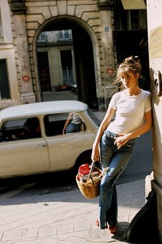 Jane Birkin goes casual in a white tee, jeans, messy up-do and basket bag