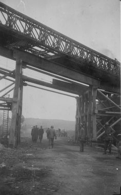 1945-04,09photo,Eisenach,Germany,First platoon building bridge across the autobahn. fixed bridge had to be built under Bailey Bridge so that traffic would not be held up.jpg (743×1200)