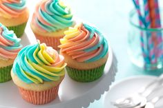 If rainbows make your day brighter, you'll love these rainbow frosted cupcakes. It's easy to turn plain cupcakes into fancy café-style confections.