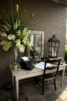 In love with this creative guest book table! The typewriter adds an elegant touch! www.idoidoweddingplanning.com