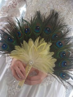 Why have a bouquet when you can have a peacock fan?! YES please!