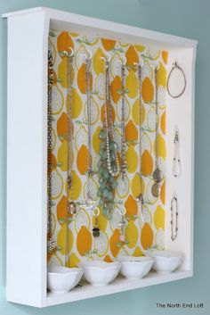 DIY Jewelry Organizer by the blog The North End Loft. a draw; painted, paper/fabric on the back for nice splash of color, bell hooks