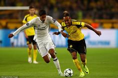 France and Real centre-back Raphael Varane (left) tries to keep pace with Dortmund's dangerman Aubameyang