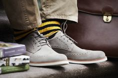 Timberland Oxfords paired with bright striped socks, as styled by GQ's Brett Fahlgren.