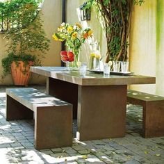 Modern concrete outdoor dining table with benches. Concrete Outdoor Dining Table, White Dining Table, Dining Table With Bench, Concrete Patio, Outdoor Tables, Outdoor Decor, Dining Tables, Outdoor Ideas, Garden Furniture