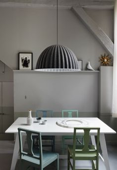 grey + green: like the pendant, like the idea of coloured chairs in this setting but somehow this room is 'lifeless'. I wonder if using a brighter hue of green and blue on the chairs could be the answer and bring in life in there.