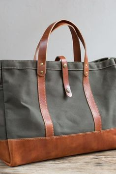 A versatile workhorse that keeps its beauty and shape, this tote is our owner and founder's bag of choice for everyday, everything and everywhere. A leather bottom makes it extra sturdy.