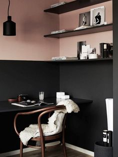 Pink and black dining space with shelves