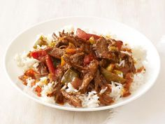 Slow-Cooker Ropa Vieja Recipe : Food Network Kitchen : Food Network Serve over rice with black beans & tortillas Crock Pot Slow Cooker, Slow Cooker Recipes, Mexican Food Recipes, Crockpot Recipes, Cooking Recipes, Slow Cooking, Cooking White Rice, Skirt Steak, Beef Dishes