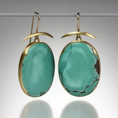 """@QUADRUM Gabriella Kiss A pair of 18K yellow gold earrings with  large oval Chinese turquoise drops measuring30 x 22mm.  Total length measures 1.75""""."""