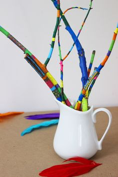 Simple and colorful Earth Day crafts for kids! Fun family art projects that you can make with sticks, paint and yarn!