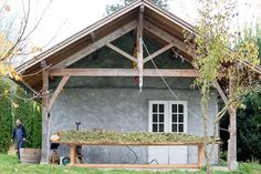 When restaurant owner Kurt Timmermeister bought a 4-acre property in the 1990s on an island in Puget Sound, it came with a historic log cabin but no kitchen. To avoid messing with history, he transformed a nearby outbuilding into a freestanding chef's dream kitchen.