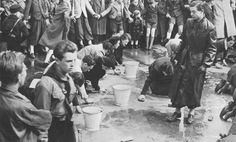 Hitler Youth forcing Jews to scrub the streets.