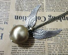 I definitely need a snitch necklace....