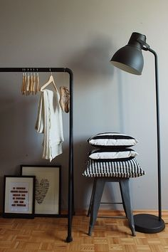 Cheap Chic ~ IKEA Hektar Floor Lamp  I thought I'd start a series featuring affordable pieces with a high end look. What with decorating my condo (my first place) I'm always on the hunt for bargain finds that only look expensive. One of my tried and...