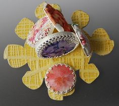Mary Curtis, New Zealand: Brooch with yellow back, Silver, wallpaper, fabric