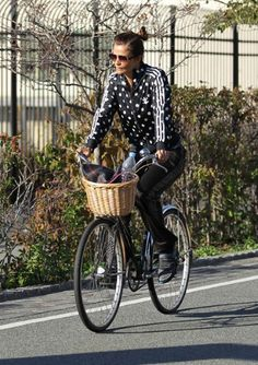Supermodel                         Helena Christensen                         gets cycling chic spot on in her polkadot Adidas tracksuit.