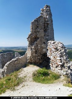 Summer view of remains of ruined fortification tower located in castle of Cachtice. This castle is situated in the mountains above the Cachtice village, Trencin region, western Slovakia. The Castle of Cachtice was residence and later the prison of the world famous Elizabeth Batory. These castle ruins are declared as National Cultural Heritage of Slovakia.