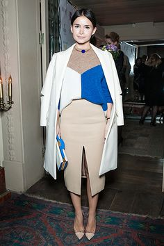 Pairing a nude front split skirt with similar tone coat and jumper with a pop of colour