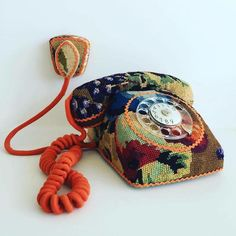 Embroidery bringing new life through textile art to old objects. A rotary telephone by Swedish designer Ulla-Stina Wikander, who covers household objects in second-hand cross-stitches Vintage Embroidery, Cross Stitch Embroidery, Embroidery Patterns, Hand Embroidery, Cross Stitches, Creative Embroidery, Needlepoint Stitches, Yarn Bombing, Molotow Marker