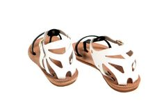 ***Orders for this listing will ship from the USA to Everywhere. Delivery within the USA takes about 3-5 business days while International delivery is within 10-12 days.***  This handmade leather sandal featuring intricate pattern is perfect for day or evening. The all leather sole will take the shape of your feet with time, giving you the best fit. The intricate cuts are reminiscent of the lace of Ancient Greece. Style them with your favourite pair of cut-offs or a maxi dress. •…