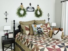 To make your bedroom wall decor easily interchangeable, install hooks on the wall and swap out wreaths and other items. • To see more of this photo and find out more about the items shown, turn to page 138 of our March 2015 issue or page 12 of our online Craft Fair, http://www.countrysampler.com/craftfair/flipbook.php?issue_code=C0315
