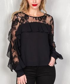 Sheer floral panels demonstrate stunning style in this trend-savvy casual top.
