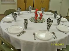 The Christmas wedding colors are black, red and white.  Very simple centerpiece but sparkly and effective.  I like to place napkins in the cups for added height.  It really adds to the table without additional cost.