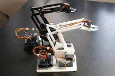 Build your own robot arm. Electronic Circuit Projects, Arduino Projects, Electronics Projects, Arduino Robot Arm, Arduino Uno, Build Your Own Robot, Diy Robot, Interactive Installation, Diy Accessories