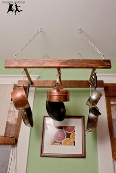 Small kitchen getting you down? Find more storage space for utensils, pots and pans, produce and your fridge with these 14 small kitchen storage hacks. Pot Rack, Kitchen Wall Rack, Small Kitchen Storage, Kitchen Decor, Old Ladder Decor, Home Decor, Kitchen Storage Hacks, Pot Hanger, Repurposed Ladders