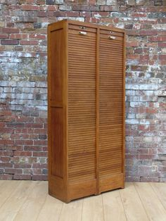 Art Deco French oak industrial double tambour front haberdashery, filing cabinet by JAC with adjustable shelving, smooth operating roller shutters and working locks and key. Shop our full collection of Storage here at Vinterior Retro Furniture, Antique Furniture, French Oak, Tambour, Mid Century Furniture, Haberdashery, Mid Century Design, Antique Art, Adjustable Shelving