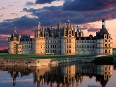 The royal Château de Chambord at Chambord, Loir-et-Cher, France is one of the most recognizable châteaux in the world because of its very distinct French Renaissance architecture which blends traditional French medieval forms with classical Renaissance structures.  Construction began in 1519.