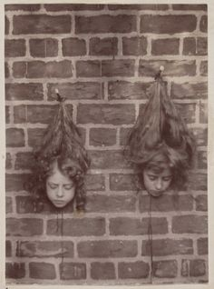 1897 trick photograph. Heads of young children suspended a on brick wall. From the State Library of Victoria Collections http://flic.kr/p/gWULDh