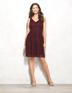 Ladies, meet your new favorite fall dress. In a figure-flattering silhouette…