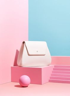 Spring/Summer Still Life Campaign for MUMU Bags. Set Design inspired by resort architecture. Images were kept in white, pink and blue tones.