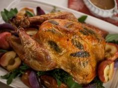 Aida's Apple and Sage Turkey : For a pretty presentation, Aida puts sage leaves under this turkey's skin and roasts it along with apples and onions.