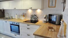 Scandinavian style kitchen with wooden worktop and white cabinet. rnrnSource by marinemess