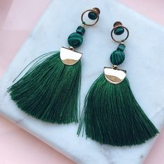 A vibrant pop of color perfect for a night out, these tassel earrings are playful in every way. Featuring green malachite juxtaposed against yellow gold. Brass base yellow gold plated Approximately in length Handmade Jewelry Designs, Custom Jewelry, Earrings Handmade, Jewelry For Her, Simple Jewelry, Jewelry Making, Green Tassel Earrings, Bead Earrings, Green Gemstones