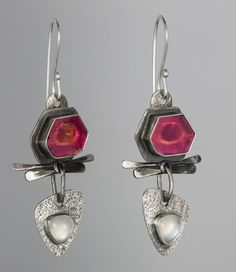 Healthy Again (earrings) by Blair Anderson. Sterling Silver, Watermelon Tourmaline, Moonstone. Watermelon Tourmaline is the focus of these earrings depicting health. The cut of these tourmalines resemble real healthy cells.
