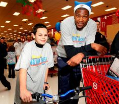 Kevin Durant of the Oklahoma City Thunder takes fans on a Thunder shopping spree as part of NBA Cares Season of Giving.