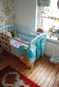 Adorable girl's nursery: vintage charm; baby blue, red and floral