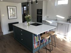 A beautiful example of one of our handmade kitchens, painted in grey and off white, with white quartz worktops