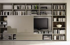 "One of the strengths of Huelsta's ""Mega-Design"" is its flexibility! Innovative functions, new options, and attractive finishes leave plenty of scope for individual combinations. This allows you to add your own unmistakable style to this living room, shelving, and library system (capable of housing audiovisual equipment)."