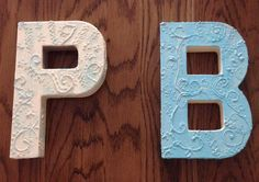 Letters with hot glue and paint.