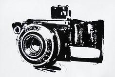 Camera print on OneKingsLane.com (would be cool w/ photos hung around it)