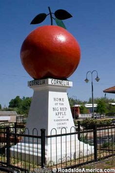 The Big Red Apple (1925) Cornelia, Georgia - It was erected at the train station as a tribute to local apple growers toward the end of WWI. It's made of steel and cement, is seven feet tall, and weighs 5200 pounds.