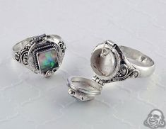 Silver and Synthetic Opal Poison Ring I love poison rings in general i just like the idea