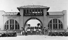 """(ca. 1947)* - Postcard view of the entrance to the Hermosa Beach pier. A Public Library is on the left and the Chamber of Commerce is on the right.           Historical Notes    The first Hermosa Beach election for city officers was held December 24, 1906. On January 14, 1907, Hermosa Beach became the nineteenth incorporated city of Los Angeles County.*^     The name Hermosa comes from Spanish and means """"beautiful."""""""
