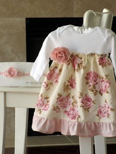 Shabby chic baby girl dress. Easy to ale from a regular white onesie....Maybe we could do a couple of these for Aurora from existing tops??