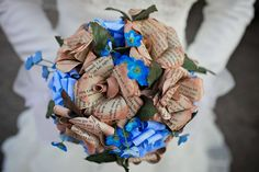 Adorable DIY blue and book wedding. I would use purple or pale pink flowers but I looooove the book flowers!!